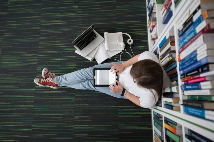 girl-sitting-on-library-floor