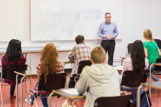 attentive-students-with-teacher-classroom_13339-60208