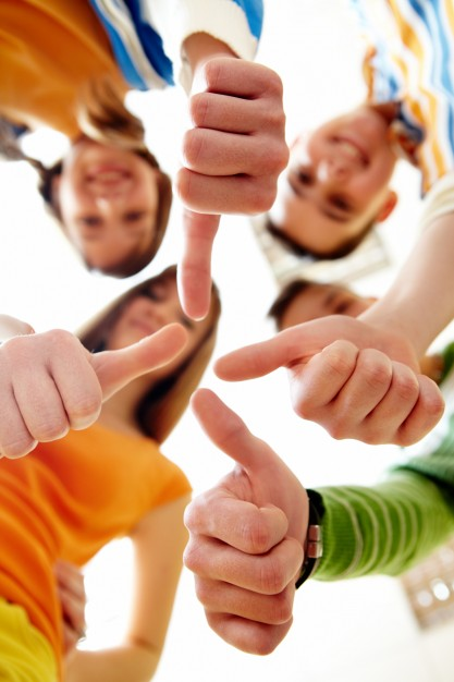 happy-group-friends-with-thumbs-up_1098-1279