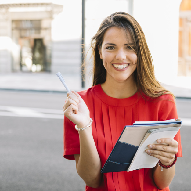 portrait-happy-young-woman-holding-diary